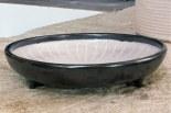 Grand plat rond décoré tripode, 1954.